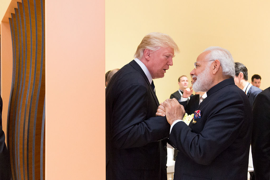 Photo of Trump and Modi greeting each other.