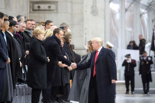 US President Donald Trump shaking hands with French President Emmanuel Macron