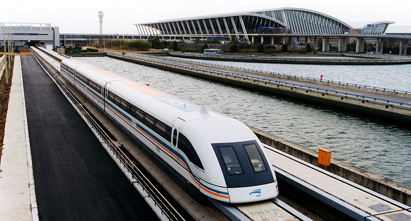 A photo of a maglev train coming out of the Pudong International Airport, Shanghai.