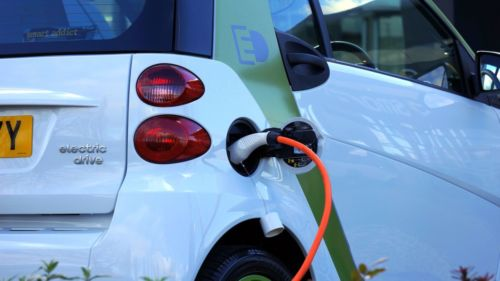 A photo of an electric car being charged