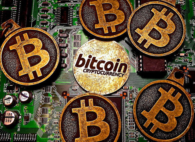 Bitcoin keychains on top of a circuit board