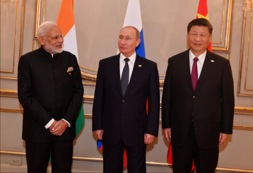A photo of Modi, Putin, and Xi standing from left to right at the G20 summit in Argentina