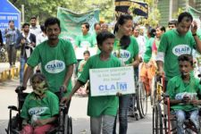 A photo of CLAIM volunteers in a protest march for clean air.