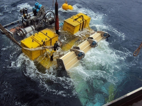 A photo of the a crawler being lowered into the sea.
