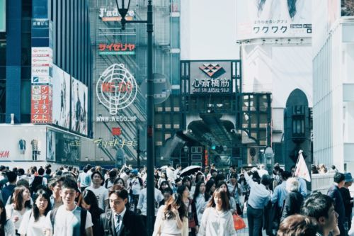 A photo of tourists milling about in a Japanese city