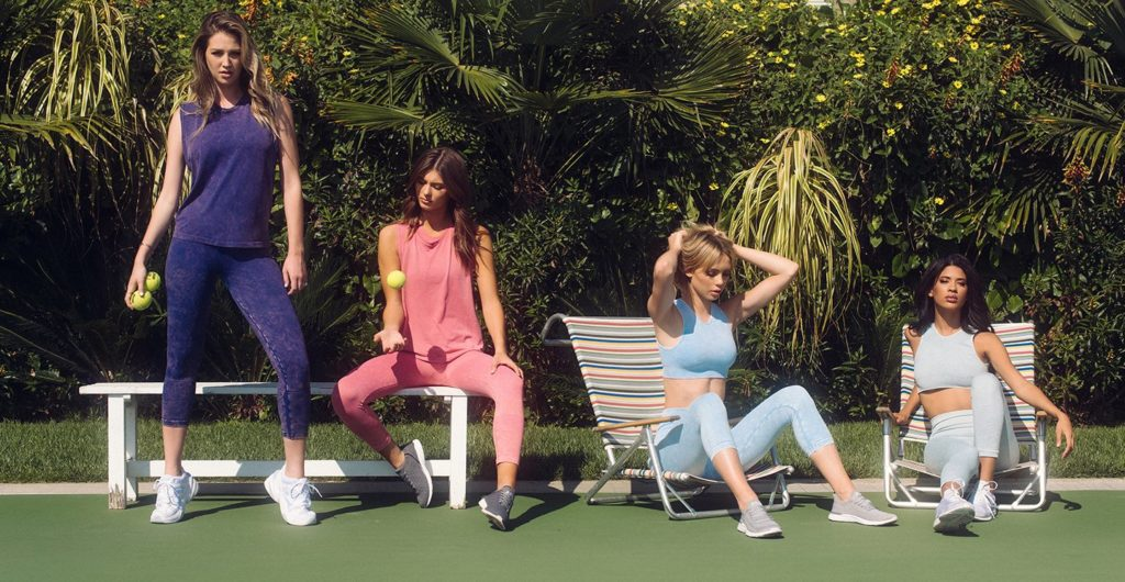 A photo of four models in athletic wear