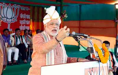 Photo of Modi addressing a rally in Assam in 2014