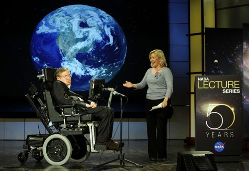 Photo of Stephen Hawking being presented by daughter Lucy Hawking on stage